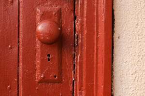 Doorknob on a red door.