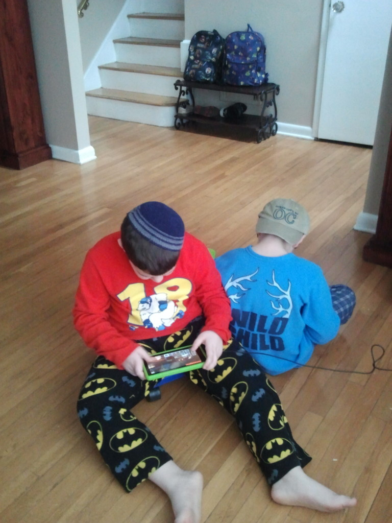 Boys focused on kindle Minecraft