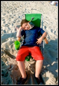 Child asleep on Ocean City Beach.