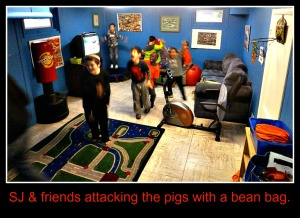 SJ an friends ready to toss the bean bags at the pigs